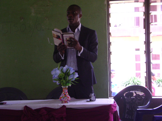 Chinedu reading from 'Purple Hibiscus'