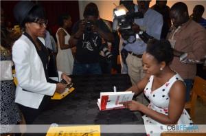 Chimamanda signing books