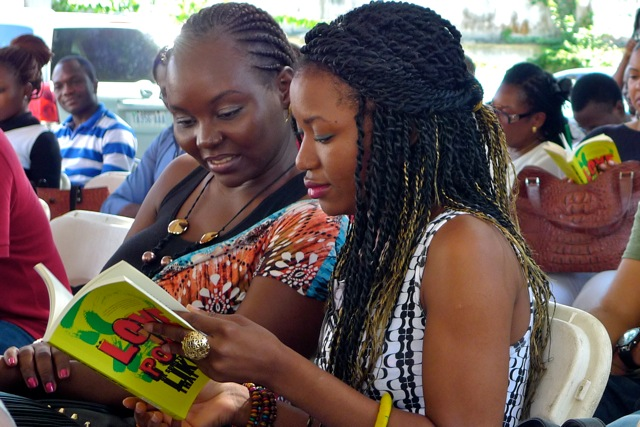 (R-L) Adebola Rayo and Aye-ola Mabiauku read along with Igoni